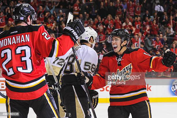 Sean Monahan and Johnny Gaudreau of the Calgary Flames celebrate after Monahan scored against the Pittsburgh Penguins during an NHL game at...