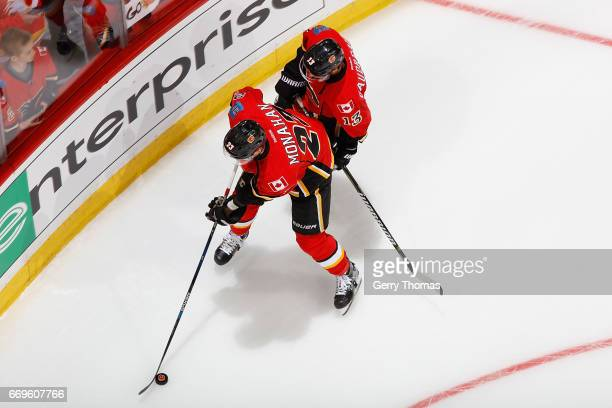Sean Monahan and Johnny Gaudreau of the Calgary Flames skate before Game One of the Western Conference First Round against the Anaheim Ducks during...