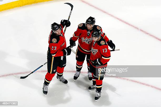 Sean Monahan Johnny Gaudreau and Jiri Hudler of the Calgary Flames celebrate a goal against the Vancouver Canucks at Scotiabank Saddledome on...