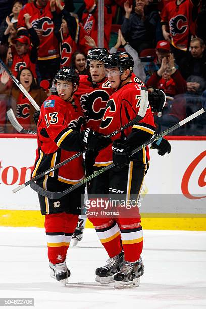 Sean Monahan Johnny Gaudreau and Micheal Ferland of the Calgary Flames celebrate a goal against the San Jose Sharks during an NHL game at Scotiabank...