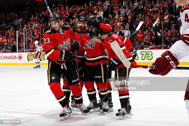 Sean Monahan Johnny Gaudreau and teammates of the Calgary Flames celebrate a goal against the Arizona Coyotes at Scotiabank Saddledome on April 7...