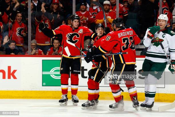 Sean Monahan Johnny Gaudreau and teammates of the Calgary Flames celebrate a goal against the Minnesota Wild during an NHL game on February 1 2017 at...