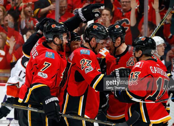 Sean Monahan Johnny Gaudreau and teammates of the Calgary Flames celebrate a goal against the Anaheim Ducks during Game One of the Western Conference...