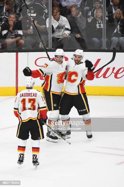 Sean Monahan Johnny Gaudreau and TJ Brodie of the Calgary Flames celebrate an overtime win against the Los Angeles Kings at STAPLES Center on October...