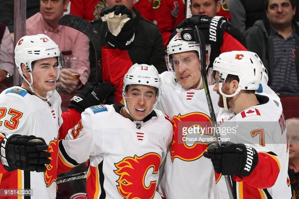 Sean Monahan Johnny Gaudreau Michael Stone and TJ Brodie of the Calgary Flames celebrate after Stone scored against the Chicago Blackhawks in the...