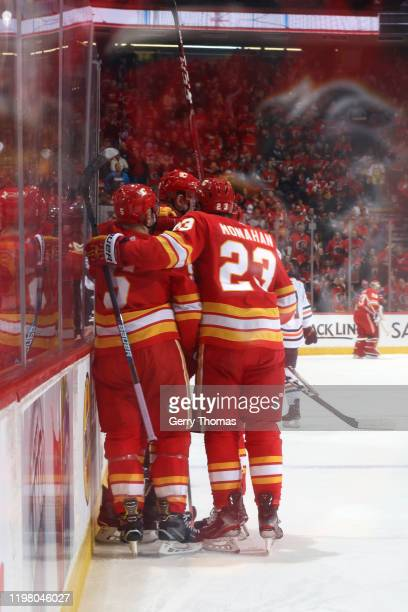 Sean Monahan Mark Giordano and teammates of the Calgary Flames celebrate a goal against the Edmonto Oilers at Scotiabank Saddledome on February 01...