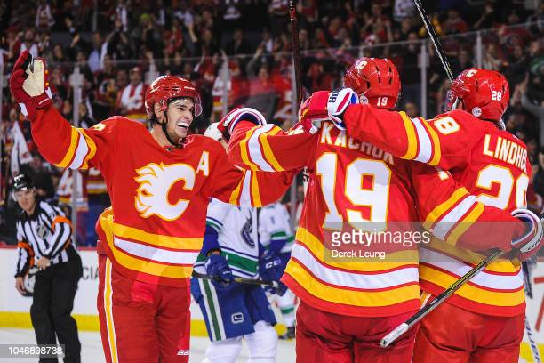 Sean Monahan Matthew Tkachuk and Elias Lindholm celebrate after Lindholm scored the gamewinning goal against the Calgary Flames celebrates of the...