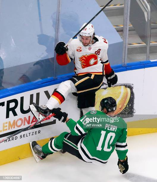 Sean Monahan of the Calgary Flames and Corey Perry of the Dallas Stars collide during the second period in Game One of the Western Conference First...