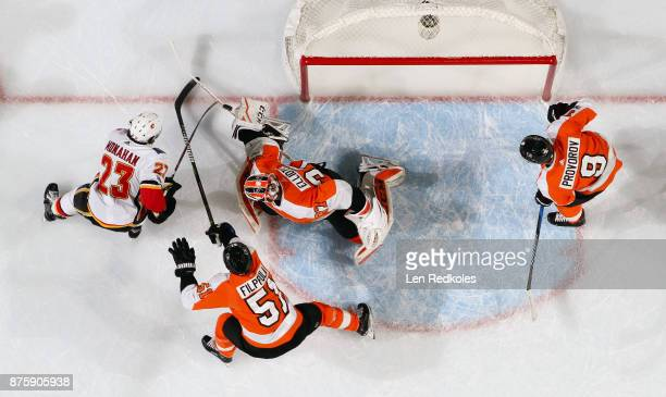 Sean Monahan of the Calgary Flames attempts a scoring chance against Brian Elliott Valtteri Filppula and Ivan Provorov of the Philadelphia Flyers on...