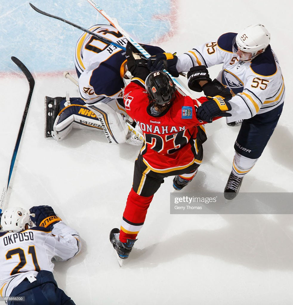 Sean Monahan #23 of the Calgary Flames battles in front against Rasmus Ristolainen #55 of the Buffalo Sabres at Scotiabank Saddledome on October 18, 2016 in Calgary, Alberta, Canada.