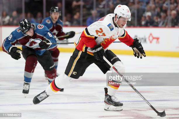 Sean Monahan of the Calgary Flames brings the puck down the ice against the Colorado Avalanche in the third period at the Pepsi Center on October 03...