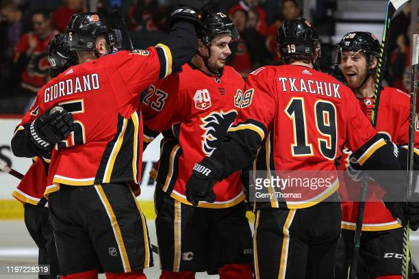 Sean Monahan of the Calgary Flames celebrates a goal against the St Louis Blues with Mark Giordano Matthew Tkachuk Johnny Gaudreau and Elias Lindholm...