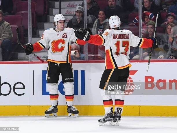 Sean Monahan of the Calgary Flames celebrates after scoring the winning goal against the Montreal Canadiens in the NHL game at the Bell Centre on...