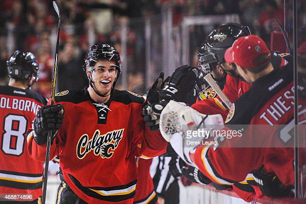 Sean Monahan of the Calgary Flames celebrates his gamewinning goal with the bench after scoring against the Arizona Coyotes during an NHL game at...