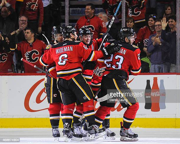 Sean Monahan of the Calgary Flames celebrates his gamewinning goal against the Arizona Coyotes during an NHL game at Scotiabank Saddledome on April 7...