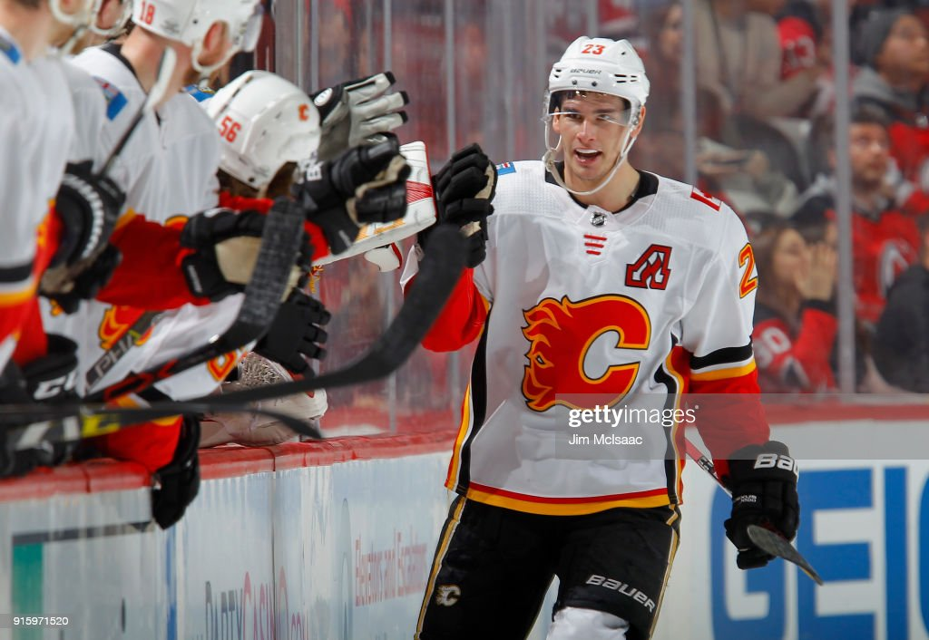 Sean Monahan #23 of the Calgary Flames celebrates his second goal of the second period against the New Jersey Devils with his teammates on February 8, 2018 at Prudential Center in Newark, New Jersey.