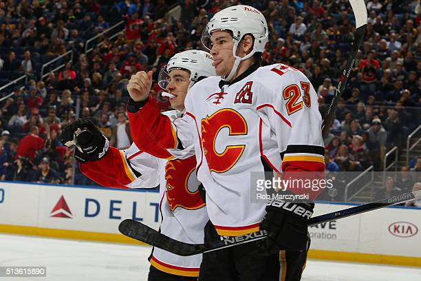Sean Monahan of the Calgary Flames celebrates his third period goal alongside Johhny Gaudreau during an NHL game against the Buffalo Sabres on March...