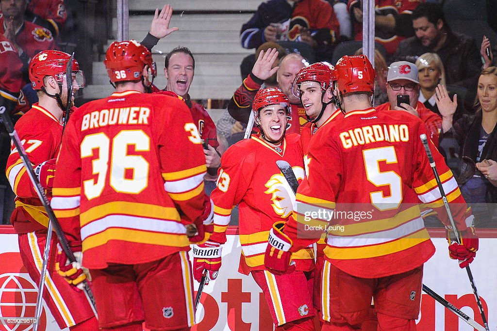 Sean Monahan #23 of the Calgary Flames celebrates with his teammates after scoring against the Winnipeg Jets during an NHL game at Scotiabank Saddledome on December 10, 2016 in Calgary, Alberta, Canada.