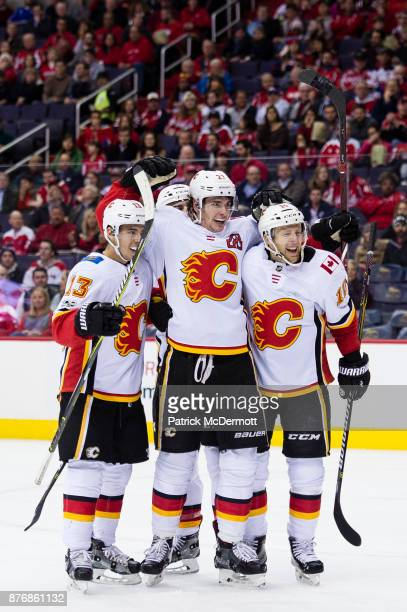 Sean Monahan of the Calgary Flames celebrates with Johnny Gaudreau and Kris Versteeg after scoring a second period goal against the Washington...