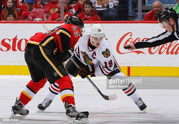 Sean Monahan of the Calgary Flames faces off against Jonathan Toews of the Chicago Blackhawks at Scotiabank Saddledome on November 20 2014 in Calgary...