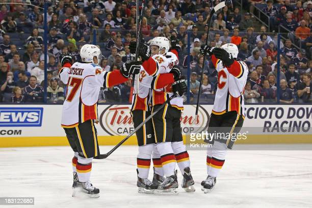 Sean Monahan of the Calgary Flames is congratulated by his teammates after scoring a goal during the first period against the Columbus Blue Jackets...