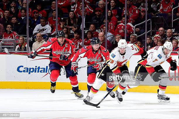 Sean Monahan of the Calgary Flames moves the puck up ice in the second period against the Washington Capitals during an NHL game at Verizon Center on...