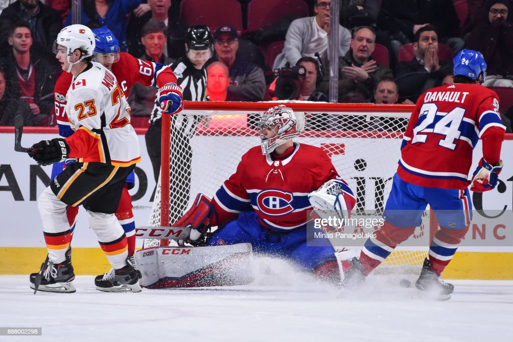 Sean Monahan #23 of the Calgary Flames scores an overtime goal against Carey Price #31 of the Montreal Canadiens during the NHL game at the Bell Centre on December 7, 2017 in Montreal, Quebec, Canada. The Calgary Flames defeated the Montreal Canadiens 3-2 in overtime.