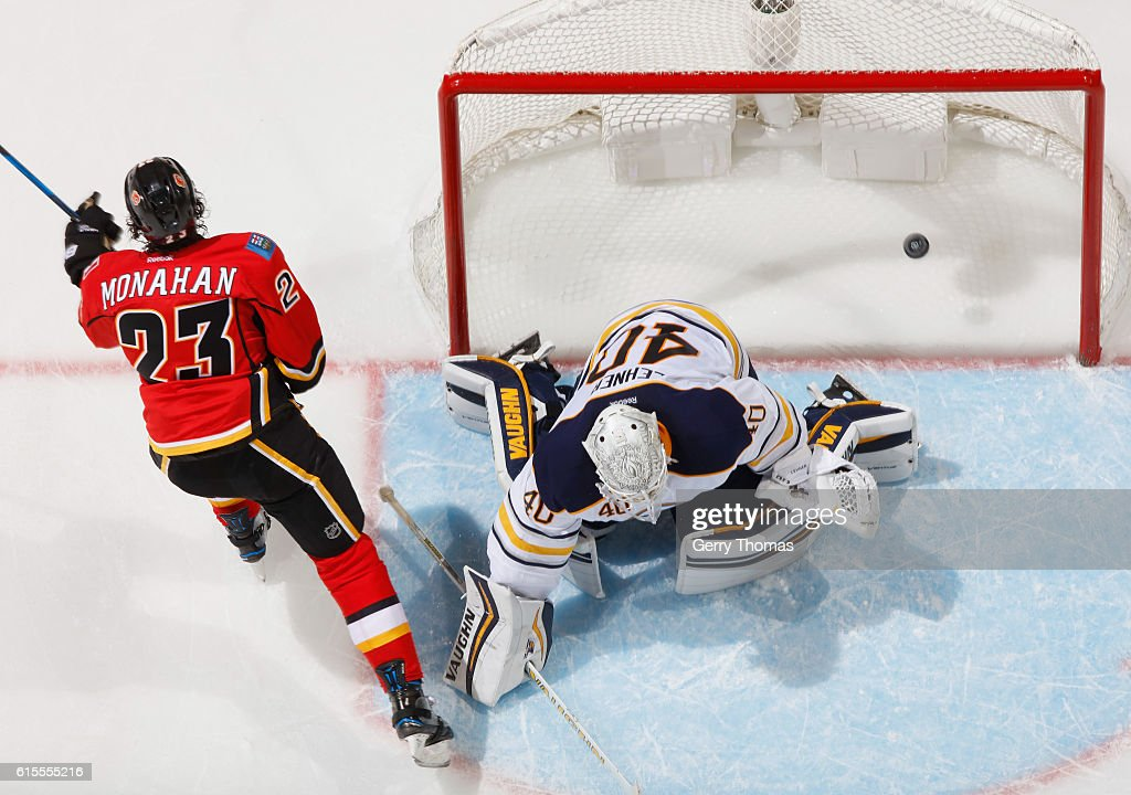 Sean Monahan #23 of the Calgary Flames scores the game winning goal against Robin Lehner #40 of the Buffalo Sabres at Scotiabank Saddledome on October 18, 2016 in Calgary, Alberta, Canada.
