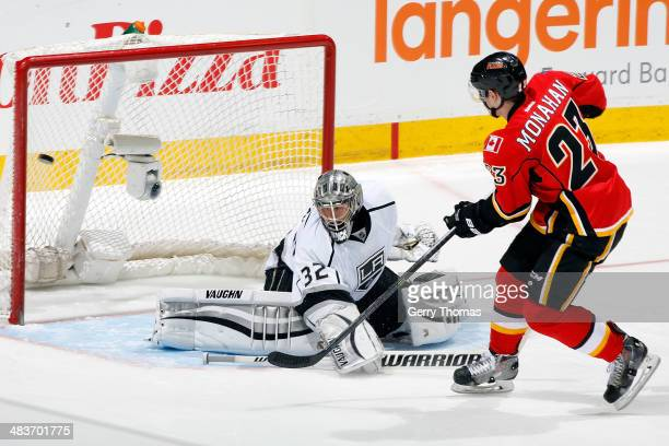 Sean Monahan of the Calgary Flames scores the game winning shootout goal against Jonathan Quick of the Los Angeles Kings at Scotiabank Saddledome on...