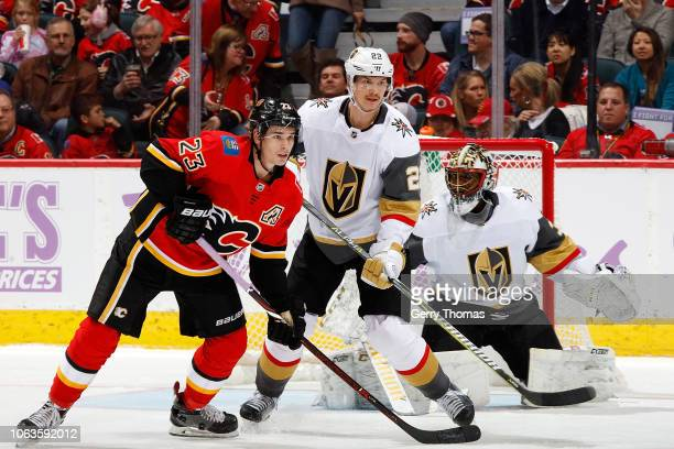 Sean Monahan of the Calgary Flames skates against Nick Holden of the Vegas Golden Knights during an NHL game on November 19 2018 at the Scotiabank...