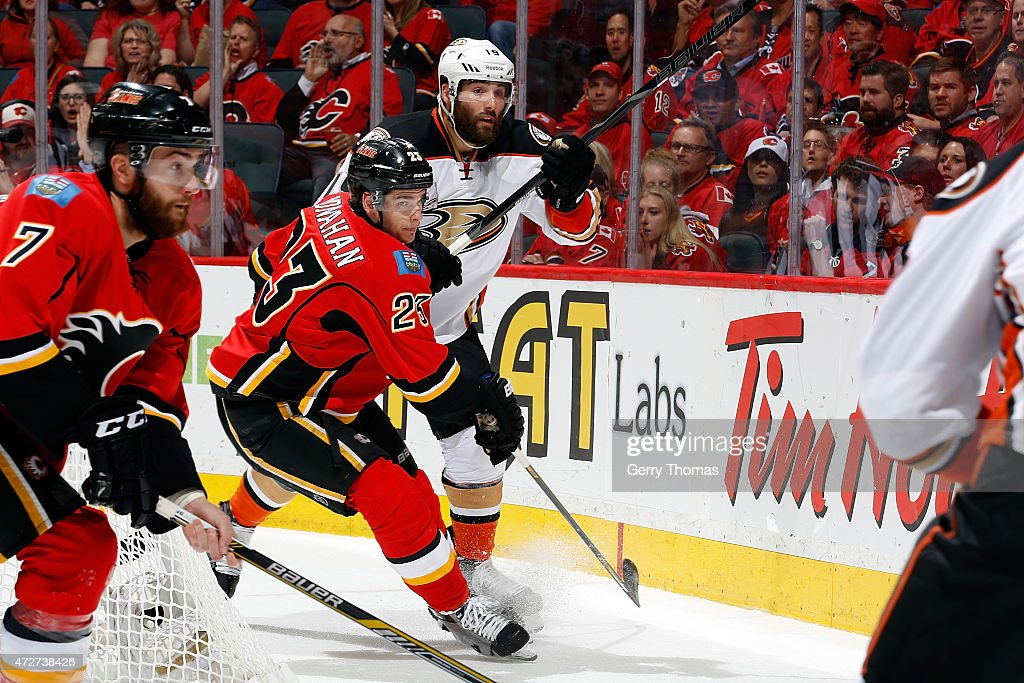 Sean Monahan #23 of the Calgary Flames skates against Patrick Maroon #19 of the Anaheim Ducks at Scotiabank Saddledome for Game Four of the Western Quarterfinals during the 2015 NHL Stanley Cup Playoffs on May 8, 2015 in Calgary, Alberta, Canada.