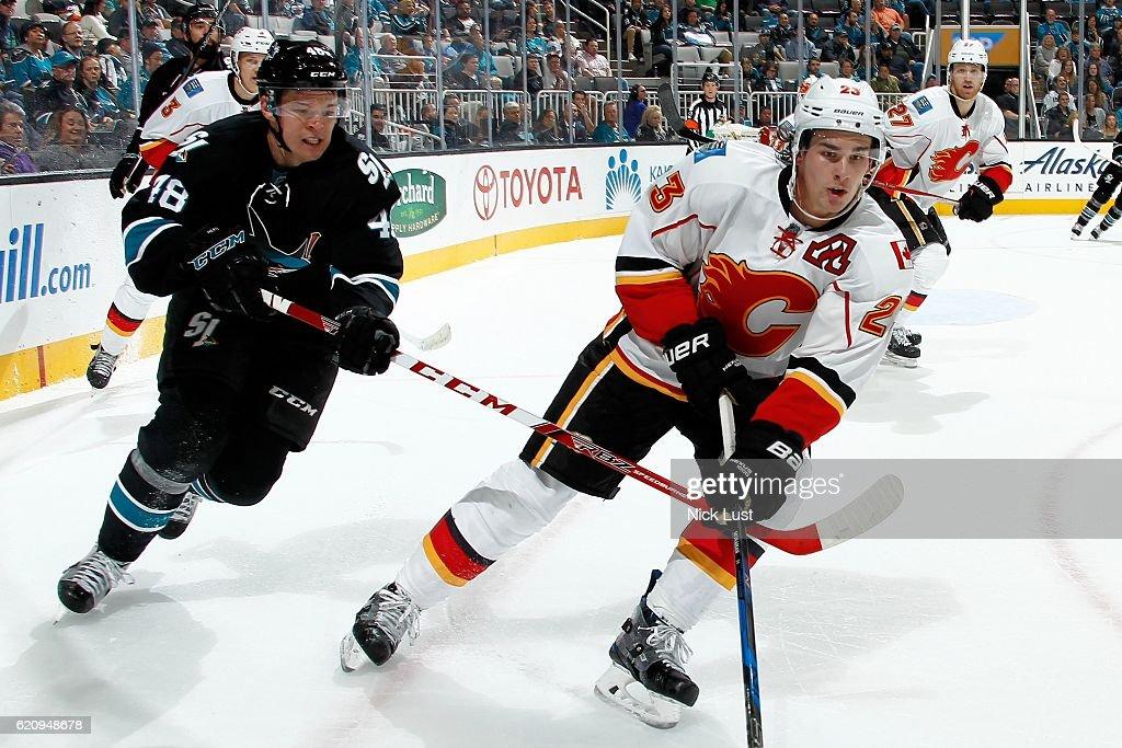 Sean Monahan #23 of the Calgary Flames skates against Tomas Hertl #48 of the San Jose Sharks skates during a NHL game at SAP Center at San Jose on November 3, 2016 in San Jose, California.