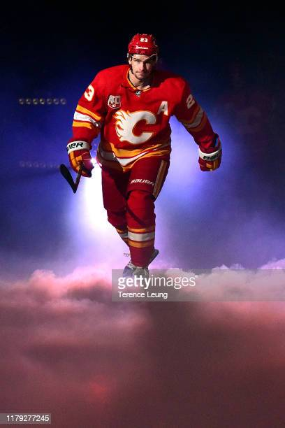 Sean Monahan of the Calgary Flames skates for the pregame ceremonies at Scotiabank Saddledome before the game against the Vancouver Canucks on...