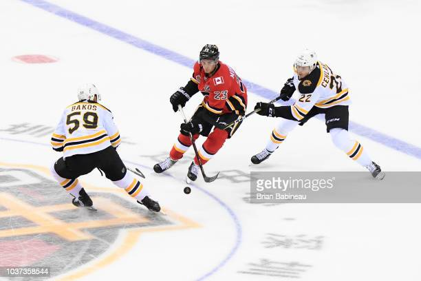 Sean Monahan of the Calgary Flames skates with the puck against the Boston Bruins at the Universiade Sports Center on September 15 2018 in Shenzhen...