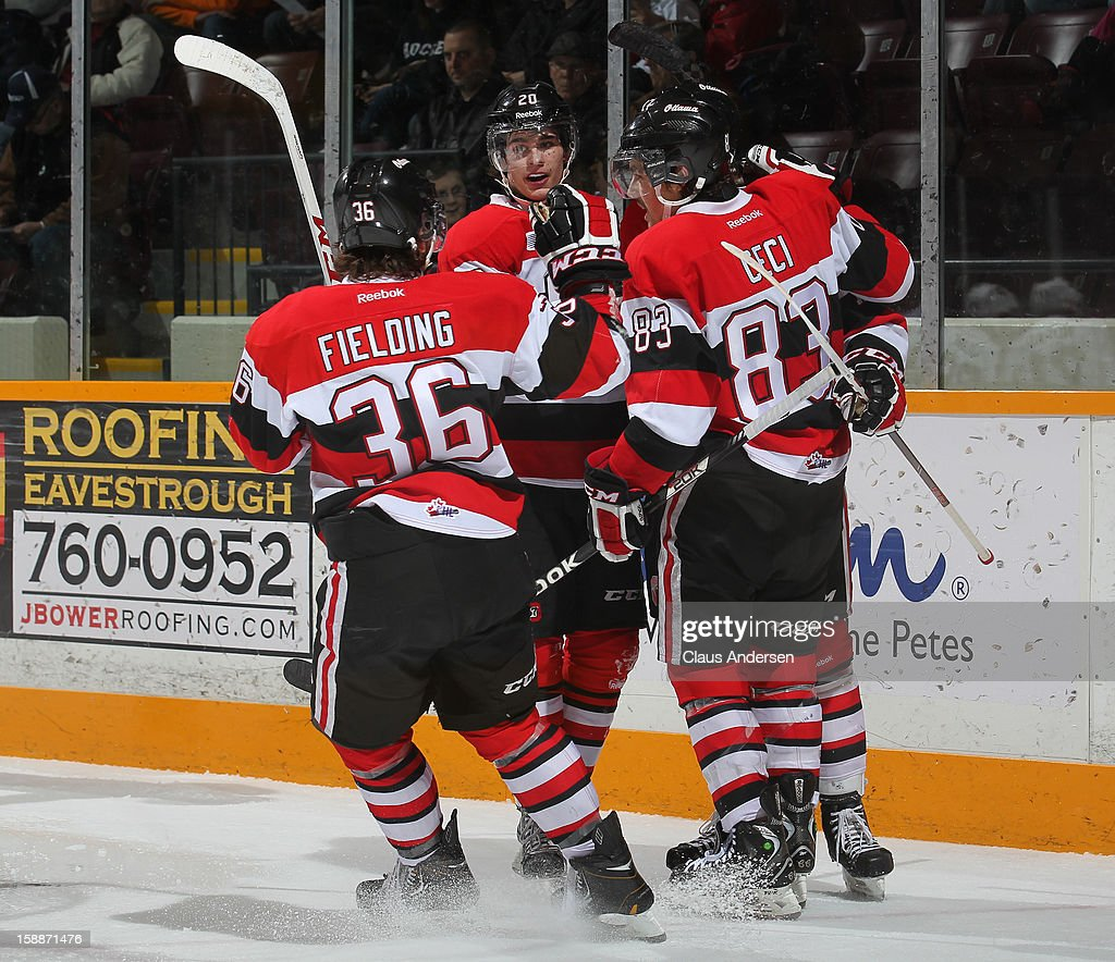 Sean Monahan #20 of the Ottawa 67's and teammates Taylor Fielding #36 and Cody Ceci #83 celebrate a goal in an OHL game against the Peterborough Petes on December 29, 2012 at the Peterborough Memorial Centre in Peterborough, Canada. The 67's defeated the Petes 6-3.