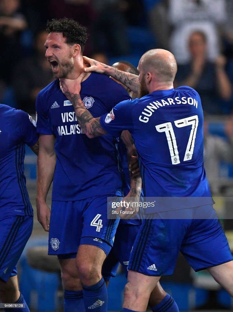 Sean Morrison of Cardiff (l) celebrates with team mates after scoring the opening goal during the Sky Bet Championship match between Cardiff City and Nottingham Forest at Cardiff City Stadium on April 21, 2018 in Cardiff, Wales.