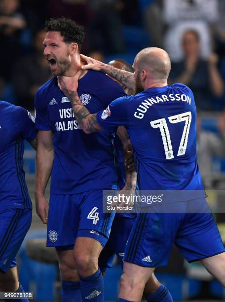 Sean Morrison of Cardiff celebrates with team mates after scoring the opening goal during the Sky Bet Championship match between Cardiff City and...