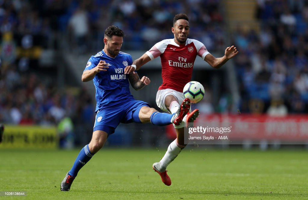 Sean Morrison of Cardiff City and Pierre-Emerick Aubameyang of Arsenal during the Premier League match between Cardiff City and Arsenal FC at Cardiff City Stadium on September 2, 2018 in Cardiff, United Kingdom.
