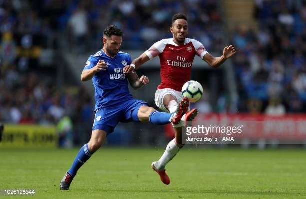 Sean Morrison of Cardiff City and Pierre-Emerick Aubameyang of Arsenal during the Premier League match between Cardiff City and Arsenal FC at Cardiff...