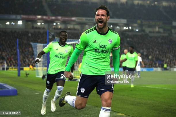 Sean Morrison of Cardiff City celebrates after scoring his team's second goal during the Premier League match between Brighton Hove Albion and...