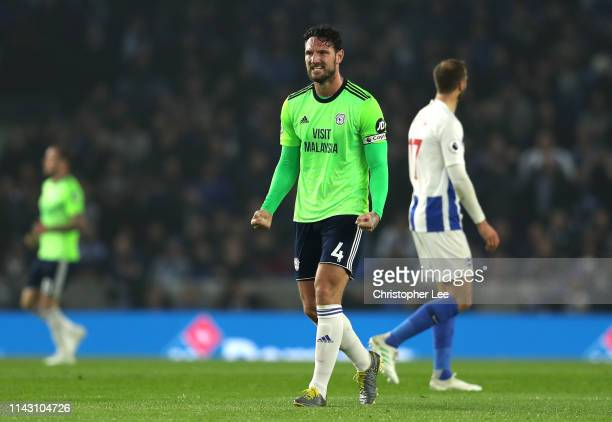 Sean Morrison of Cardiff City celebrates his sides first goal during the Premier League match between Brighton Hove Albion and Cardiff City at...