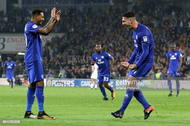 Sean Morrison of Cardiff City celebrates scoring his sides third goal of the match with team mate Nathaniel MendezLaing during the Sky Bet...