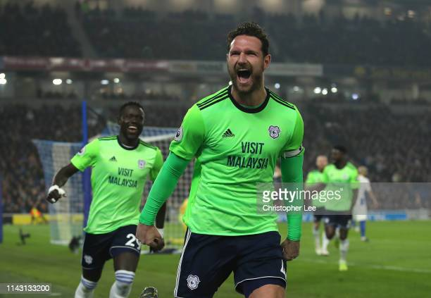 Sean Morrison of Cardiff City celebrates scoring their second goal during the Premier League match between Brighton Hove Albion and Cardiff City at...