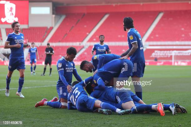 Sean Morrison of Cardiff City celebrates with his team mates after scoring their first goal during the Sky Bet Championship match between...