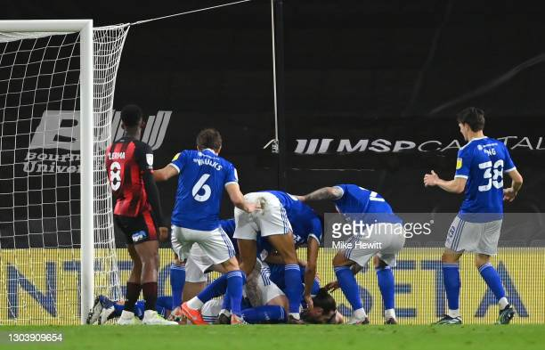 Sean Morrison of Cardiff City celebrates with team mates after scoring their side's first goal during the Sky Bet Championship match between AFC...