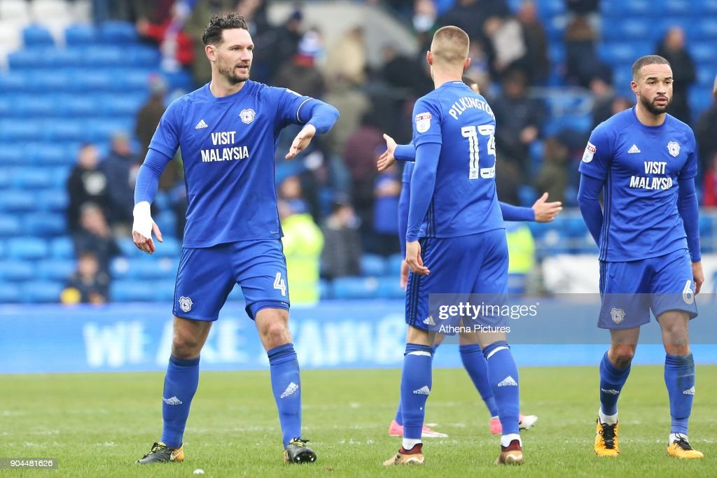 Sean Morrison of Cardiff City high fives Anthony Pilkington after the final whistle of the Sky Bet Championship match between Cardiff City and Sunderland at the Cardiff City Stadium on January 13, 2018 in Cardiff, Wales.