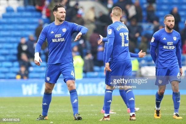 Sean Morrison of Cardiff City high fives Anthony Pilkington after the final whistle of the Sky Bet Championship match between Cardiff City and...