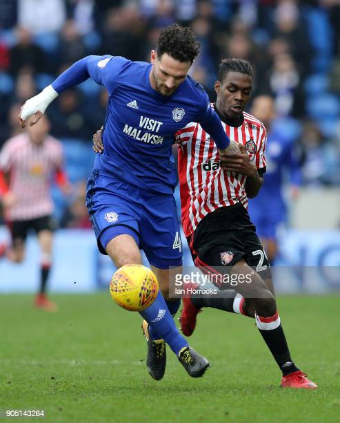 Sean Morrison of Cardiff City holds off Joel Asoro during the Sky Bet Championship match between Cardiff City and Sunderland at Cardiff City Stadium...