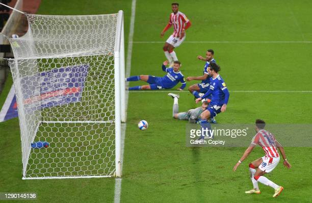 Sean Morrison of Cardiff City scores an own goal during the Sky Bet Championship match between Stoke City and Cardiff City at Bet365 Stadium on...