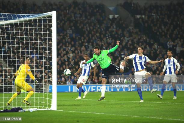 Sean Morrison of Cardiff City scores his team's second goal past Mathew Ryan of Brighton and Hove Albion during the Premier League match between...